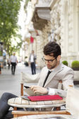 Businessman sitting at coffee shop — Stock Photo