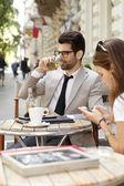 Businessman with businesswoman at coffee shop — ストック写真