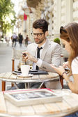 Businessman and business woman at coffee shop — Stock Photo