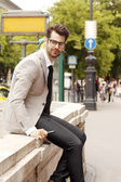 Businessman at the city — Stock Photo
