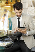 Modern businessman with digital tablet — Stock Photo