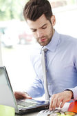 Businessman working at office with laptop — Stock Photo