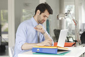 Businessman sitting at office — Stock Photo