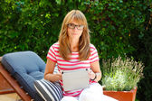 Modern business woman working at home — Stock Photo