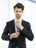 Young businessman standing at office — Stock Photo