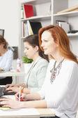Teamwork at modern graphic design studio — Stock Photo