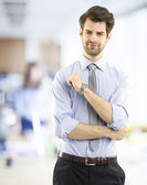 Businessman standing at office — Stock Photo