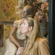 Stock Photo: Blond woman window shopping