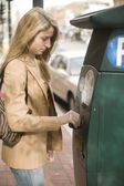 Woman buying parking ticket — Stock Photo