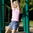 Girl on monkey bars — Stock Photo