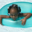 Young black girl playing in swimming pool — Stock Photo #23190106