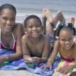 African American family at the beach — Stock Photo