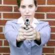 Woman pointing gun — Stock Photo