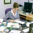 Woman in messy office — Stock Photo