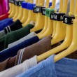Clothes hanging on rails — Stock Photo #23794197