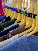 Clothes hanging on rails — Stock Photo