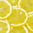 Lemon slices background — Stock Photo #24018061