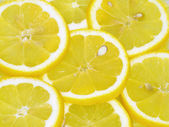 Lemon slices background — Stock Photo