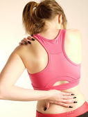 Woman with back and neck pain — Stock Photo