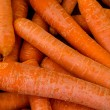 Carrots background — Stock Photo #24930011