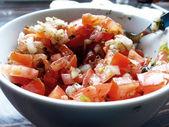 Bruschetta with tomato and onion ingredient — Stock Photo