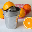 Juicer and orange — Stock Photo