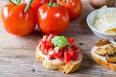 Bruschetta with beans and arugula, mushrooms, goat cheese — Stock Photo
