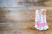 Kitchen towel background with wooden spoons — Stock Photo