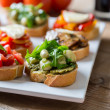 Bruschetta with beans and arugula, mushrooms, goat cheese — Stock Photo #38293953