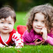 Young Sisters In The Grass — Stock Photo