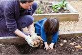 Mother and Child Gardening — Stock Photo
