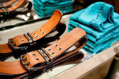 Clothes and Belts On a Rack — Stock Photo