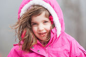 A Young Girl Braves The Cold and Snow — Stock Photo
