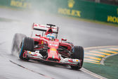 Ferrari F1 team in action  in the wet at the Australian Grand Pr — Stock Photo