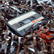 Stock Photo: Cassette and tape background