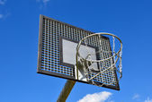 Basketball rim, streetball hoop against blue sky. — Stock Photo