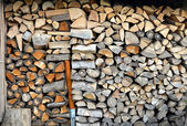 Firewood stacked stove or fireplace, wood pile — Stock Photo