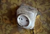 Closeup of vintage dirty electrical outlet on wall. Old wallpape — Stock Photo