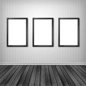 Three empty frames on a wall  — Stock Photo