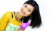 Young women and home cleaning products — Stock Photo