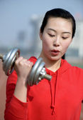 Fitness woman working out with dumbbell — Stock Photo