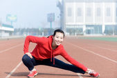 Young woman in sport wear doing sport — Stock Photo