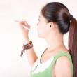 An oriental woman in front of a whiteboard pen to write — Stock Photo