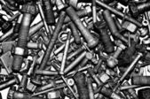 Dirty metal nuts and bolts. — Stock Photo