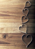 Valentine's day paper hearts on wooden background. — Stock Photo