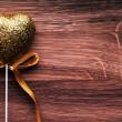 Valentine golden heart on wooden background. — Stock Photo