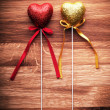 Valentine red and golden hearts on wooden background. — Stock Photo
