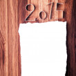 White blank paper for 2015 year on oak wooden background. — Stock Photo
