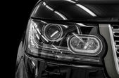 Closeup headlights of car. — Stock Photo