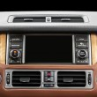 Panel of a modern car. Screen multimedia system. — Stock Photo